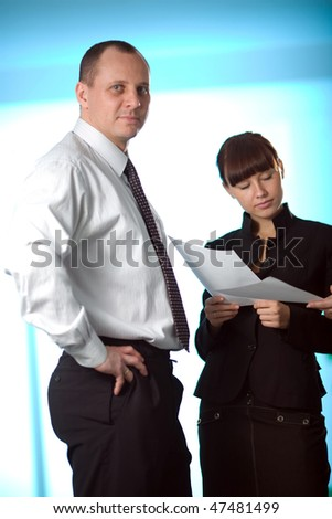 Men and girl with paper on blue background
