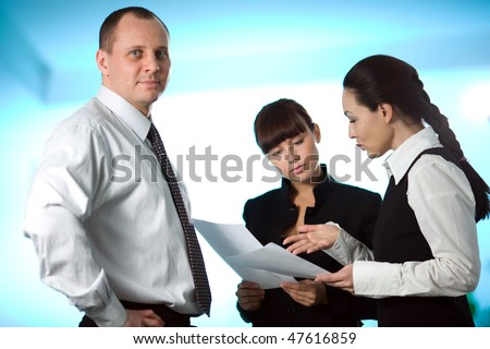 Men and girl with women on blue background - stock photo