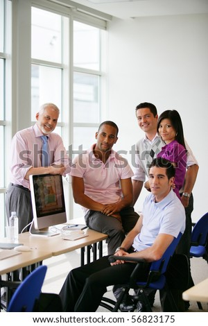 Men and woman in front of a desktop computer
