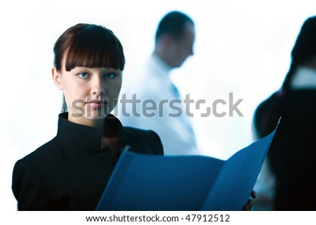 Men and women and nice girl with blue folder - stock photo