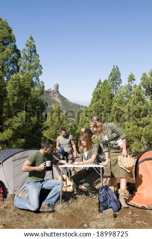 men and women group with maps and climb material - stock photo