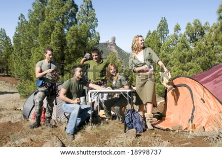 men and women group with maps and climb material at the mountain in camping - stock photo