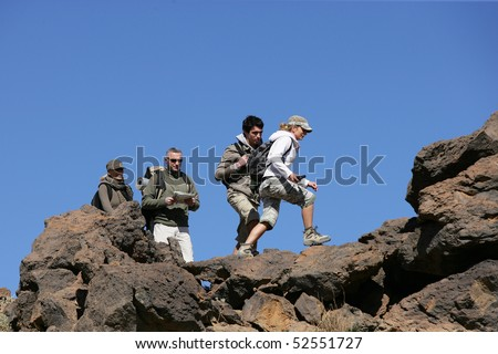 Men and women making some hike - stock photo