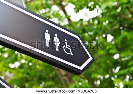 Men and women toilet sign with an arrow showing direction - stock photo