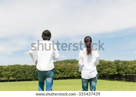 Men and women walking - stock photo