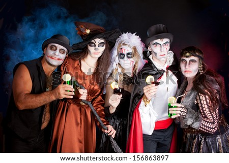 men and women wearing as vampire, witch, dead bride for Halloween