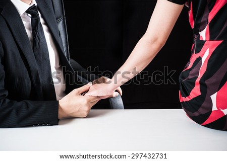 Men and women who have committed holding hands