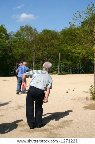 Men are playing of bowls, french game. - stock photo