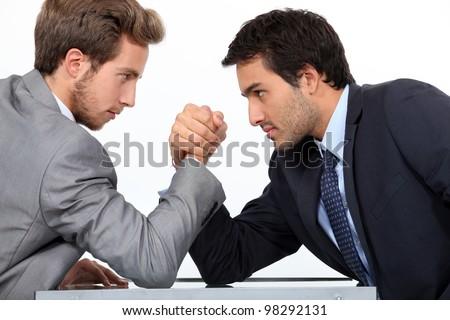 Men arm wrestling - stock photo