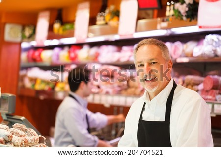Men at work in a grocery store - stock photo
