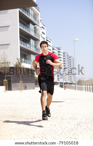 Men athlete running at the city - stock photo