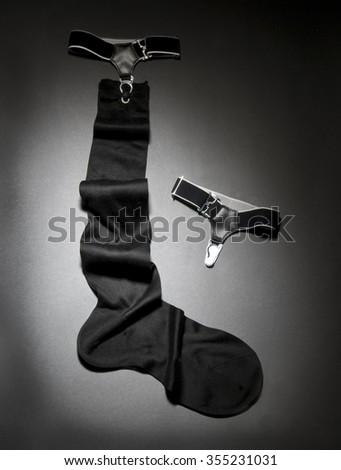 men black sock on a grey gradient background - stock photo