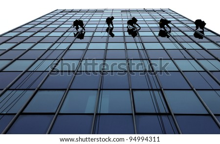 Men cleaning windows on a high rise building