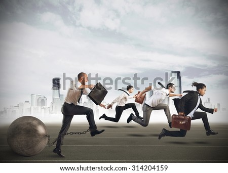 Men competing with a man with obstacle - stock photo