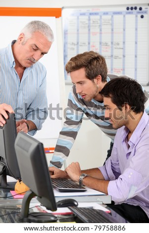 Men connecting to Internet in classroom - stock photo