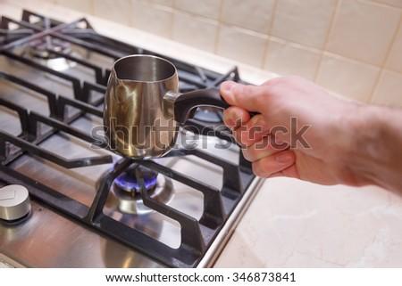men cook coffee stove kitchen - stock photo