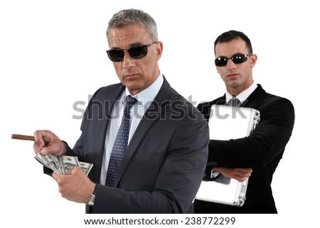 Men counting money - stock photo