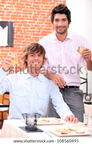 Men drinking champagne in a restaurant