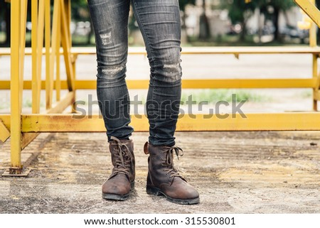 Men fashion in brown leather boots  - stock photo