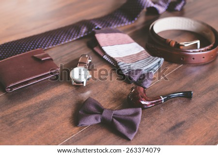 Men fashion. Men accessories. Men socks, wallet, belt, watch, tie, bow tie and smoking pipe. Still life. Business look.  - stock photo