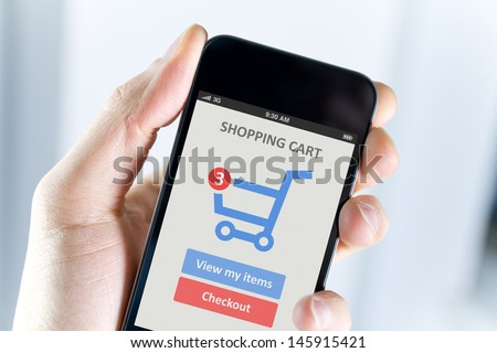 Men hand holding modern mobile phone with online shopping application on a screen.  - stock photo