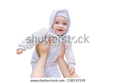 Men hands are raising a smiling child up high isolated on white background - stock photo