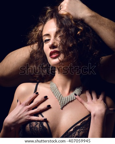 Men hands give expensive present jewelry to elegant fashionable woman girlfriend on a black background
