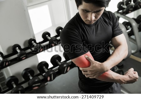 Men have been injured in the arm by a weight lifting exercise in gym - stock photo