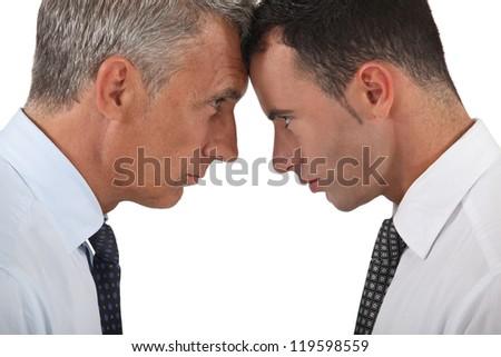 Men head butting - stock photo