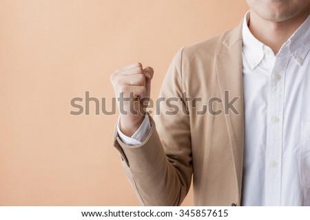 Men holding hands - stock photo