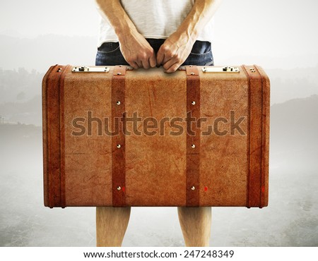 men holding leather suitcase on a white background - stock photo