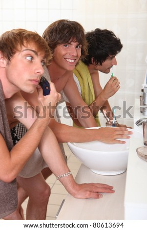 men in a bathroom - stock photo