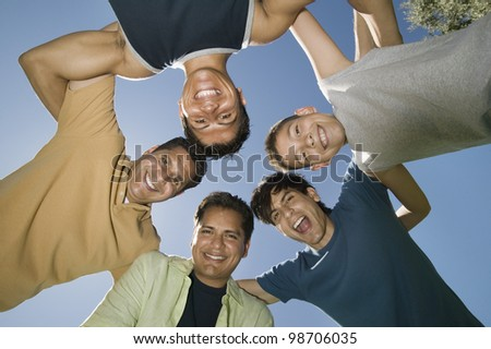Men in a Huddle - stock photo