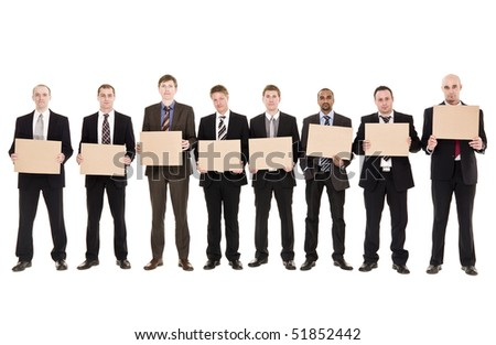 Men in a row holding signs isolated on white background - stock photo