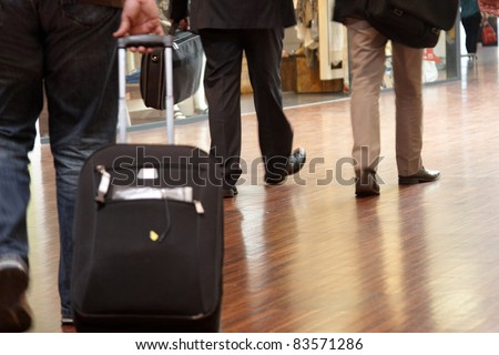 Men in an airport with their baggage - stock photo