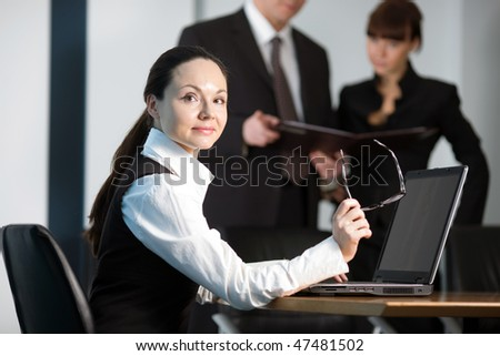 Men in black jacket with girl and women at table - stock photo