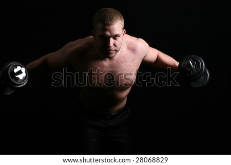 Men in dark. Naked torso. With dumbbells - stock photo
