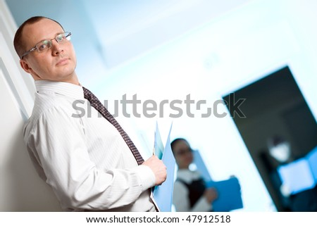 Men in glasses with tie and with paper - stock photo