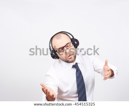 Men in headphones listens to music and sings. Isolated on a white background. - stock photo