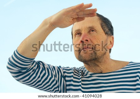 Men in stripped clothing looking afar - stock photo