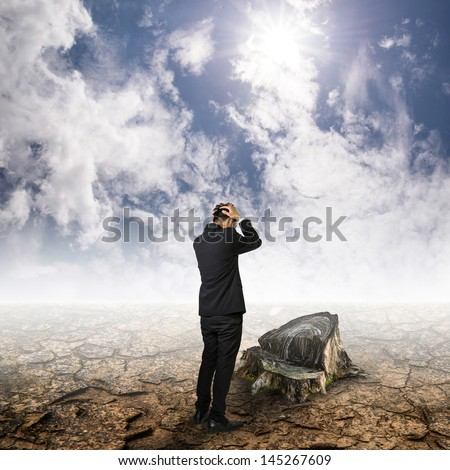 men in suit stand unhappy on cracked ground look stump