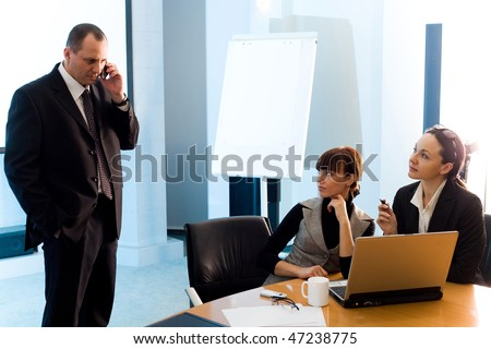 Men in suit with girl and women - stock photo