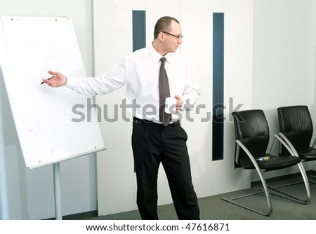 Men in tie with cup - stock photo