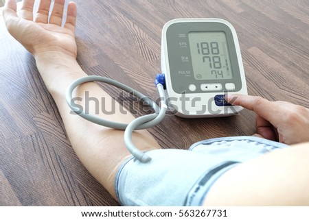 Men is taking care for health with hearth beat monitor and blood pressure.Health concept