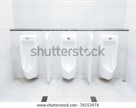 Men lavatory in modern building - stock photo