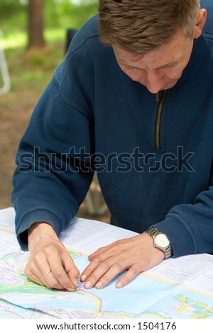Men looks at a map. - stock photo