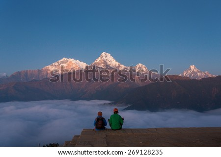 Men meditating in Himalaya Mountains View from Poon Hill 3210m at sunset - stock photo