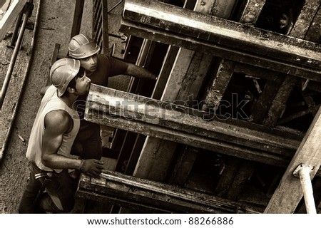 men on a construction site - stock photo