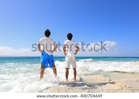 Men on a tropical beach