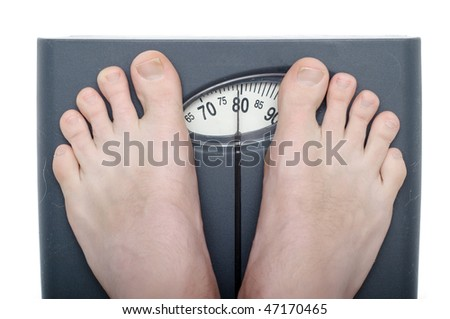 Men on bathroom scale isolated